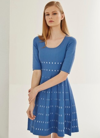 Two-tone knit dress with a subtle perforated design and a fully flared skirt. The dress itself has a striped design on the underside of inner face, plus a crew neck and short sleeves.