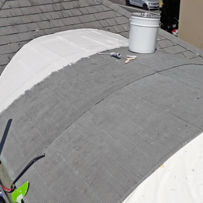 Reinforced roof coating