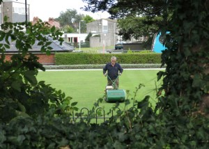 Cutting the grass of the Bowling Green. Maes bowlio, Abergele. Photo taken by Sion Jones in 2014