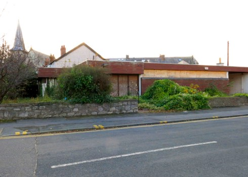 Abergele's old doctors' surgery, pictured in 2014 . Photo by Sion Jones. There used to be yellow panels along the roof. I think the architect was Bill Davies.
