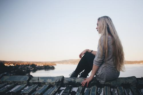 Girl sitting on dock picture.