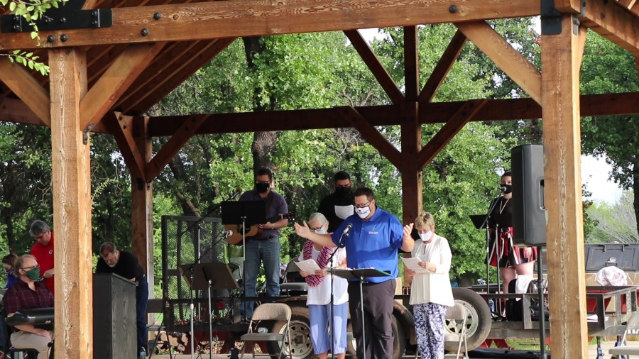 Pastor Nick leads Worship outside during COVID-19