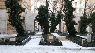 The 24 mass graves. Over two thousand of those who died in the ghetto from hunger and cold during the winter 1944-1945 are buried in the courtyard of the synagogue.