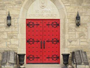 Red front door of the church.