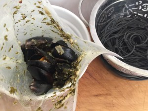 cut open bag and ad pasta and mussels to the same pot to toss together before serving
