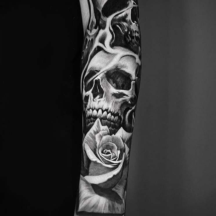 skull-rose-skeleton-arm-sleeve-tattoo.jpg