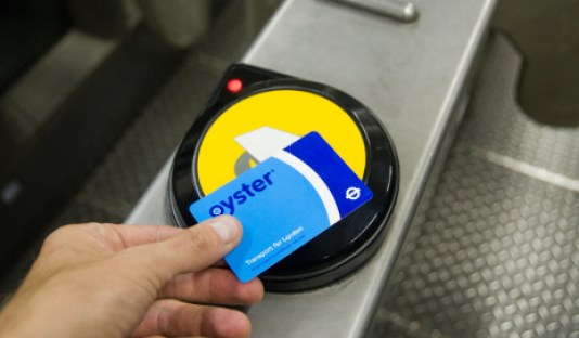 Oyster card London travel public transport navigating the tube underground swipe or tap in