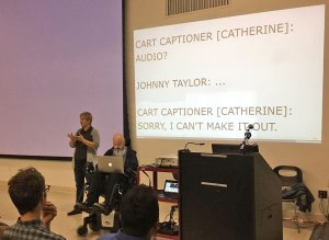 I'm front and centre at Accessibility Toronto Camp 2016, between a sign-language interpreter and the podium, with my laptop on my lap, speaking words on my behalf.