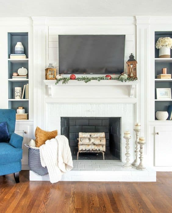 Love how beautiful the blue pops with this simple fall mantel decor.