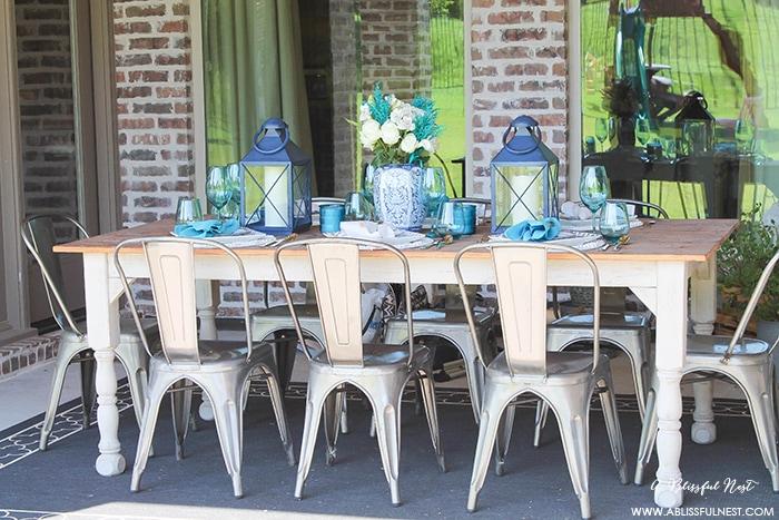Fresh coastal table décor ideas for the perfect summer night. Grab these tips on setting the perfect coastal tablescape by A Blissful Nest. https://ablissfulnest.com/ #coastal #tabledecor #tabledecorideas #coastalinteriors #coastalroom #ocean #blueandwhite