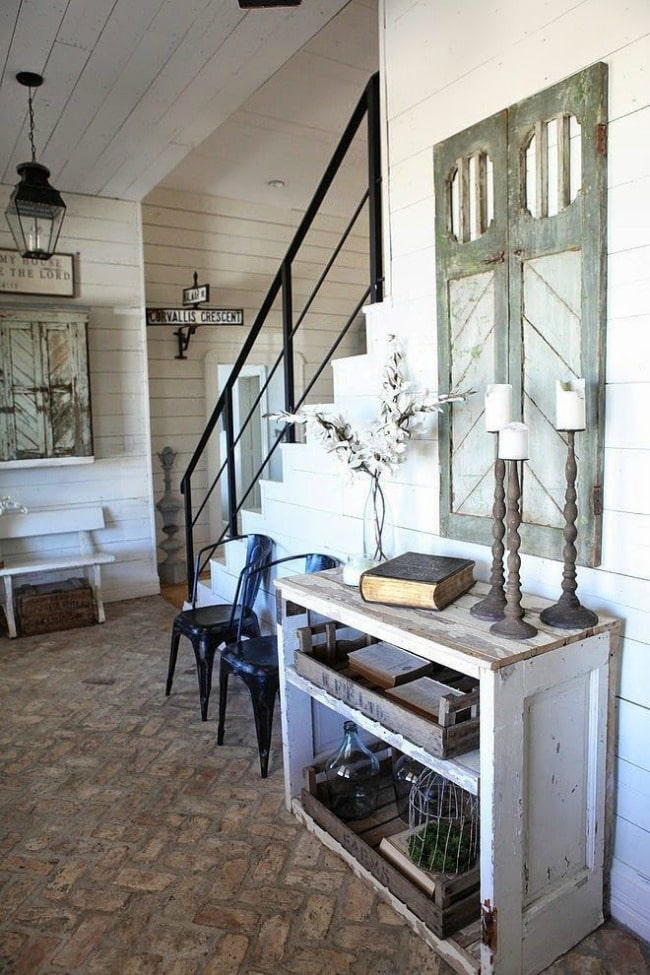 Love this entryway! It's the perfect farmhouse style with repurposed wood accents everywhere. Cote de Texas, 20 Best Fixer Upper Rooms