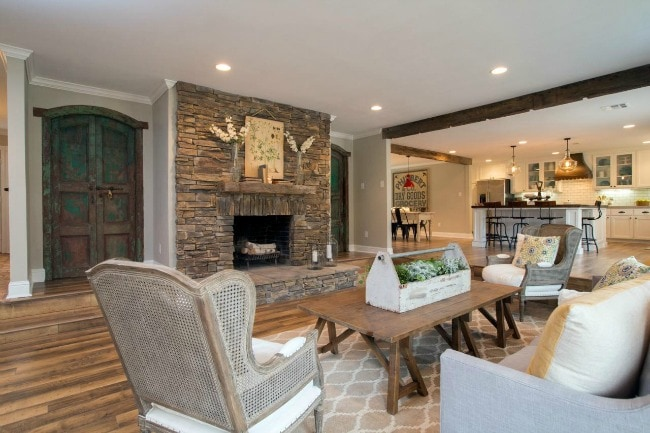 This living room feels so spacious and open - and I don't know if those doors lead anywhere but they're gorgeous! HGTV Fixer Upper Show, 20 Best Fixer Upper Rooms