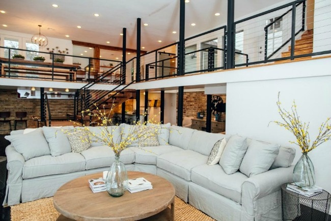 This living room is the perfect combination of modern design with a cozy at-home feeling. The metal railings are so sleek, while the rest of the decor welcomes you home. HGTV Modern Coastal, 20 Best Fixer Upper Rooms