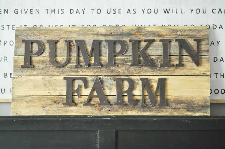 This is one fall project you can definitely make yourself! This DIY pumpkin farm pallet sign will infuse a little farmhouse decor into your home! See more on https://ablissfulnest.com/ #falldecor #pumpkinideas #palletsign #falldecorations