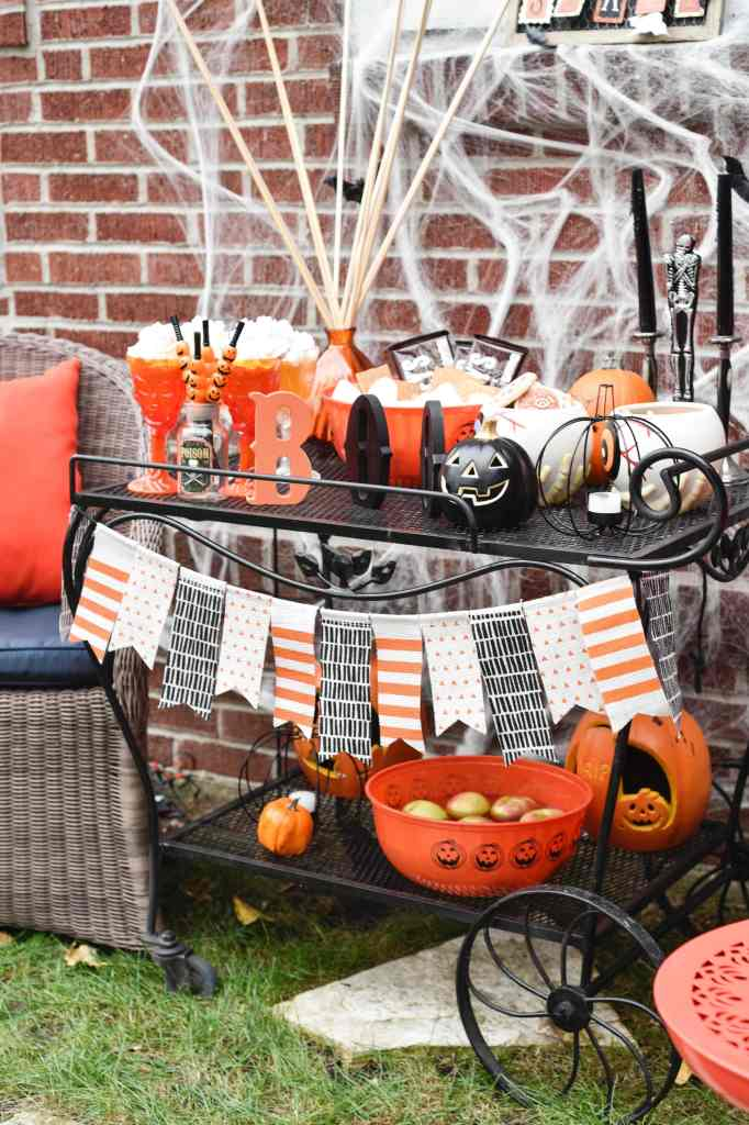 This Halloween Bar Cart isn't only for adults, this adorable cart is kid-friendly and oh so fun! Such a great way to celebrate this fun holiday! https://ablissfulnest.com/ #Halloween #Entertaining #HalloweenParty