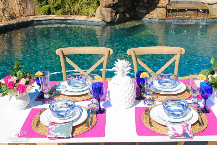 A bright and fresh spring table setting idea perfect for Easter, Mother's Day or a pool party! See more on https://ablissfulnest.com/ #tablesetting #tablescape #springtabledecor