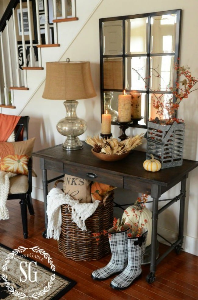 Adore this fall entryway by Stone Gable. Grab the best fall entryway ideas on https:ablissfulnest.com/ #falldecor #falldecorating #fallentrydecor