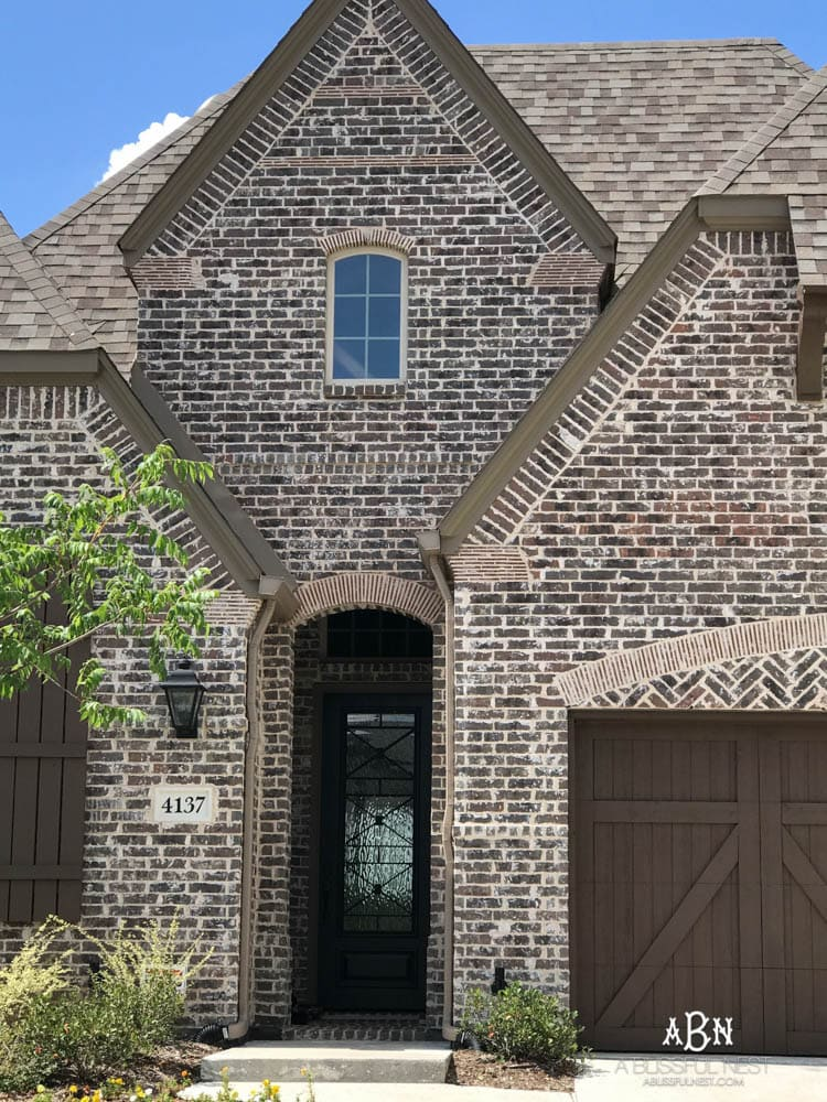 This is a beautiful brick exterior. If I was trying to figure out how to choose brick for your home, I'd start here! Love these brick selections for this exterior brick home being built. #exterior #homeexterior #homebuild