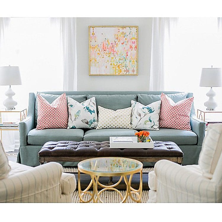Love the look of these five throw pillows on this couch. The smaller pillow in the center really evens out the look of the two larger pillows on each side