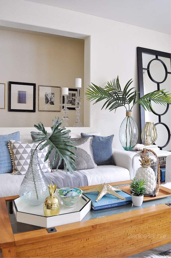 The mixed patterns and textures of throw pillows on this couch match the different textures and styles of decorations in the room around the couch