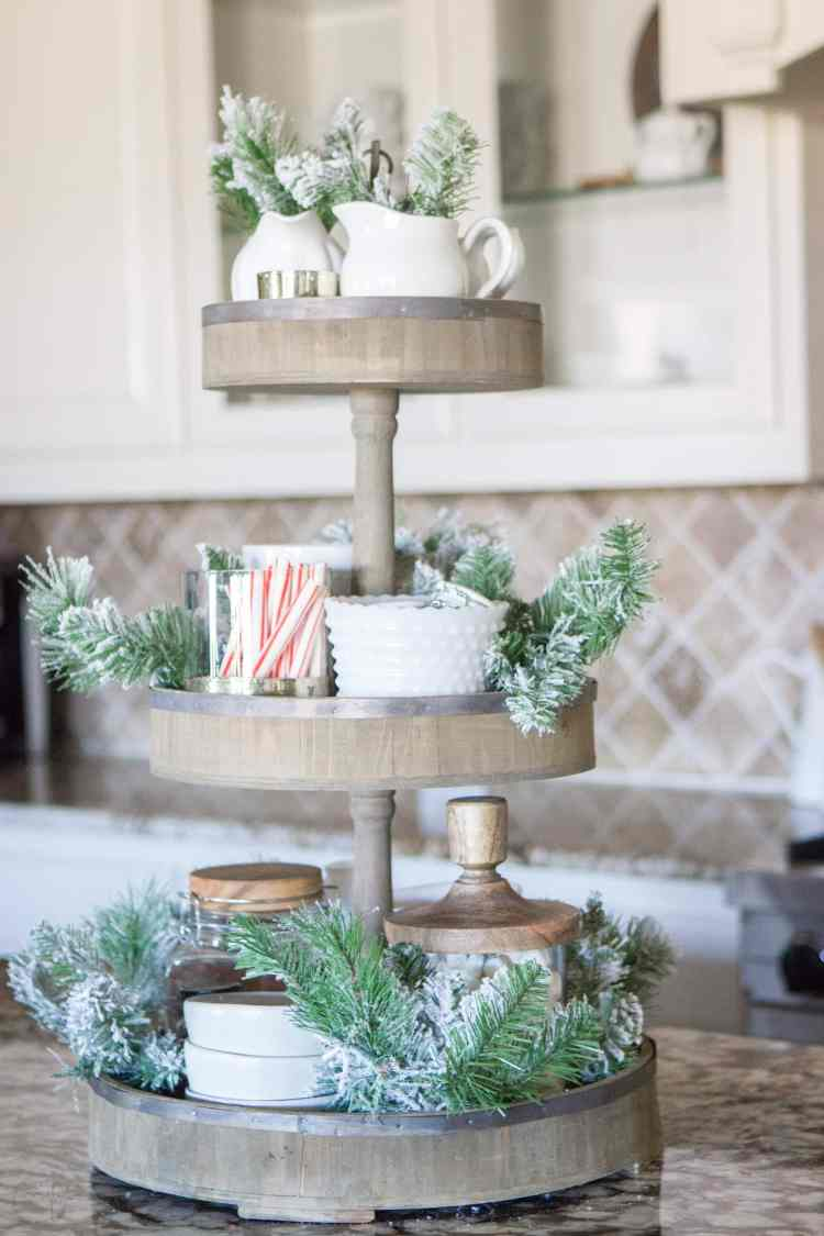 A Fully Stocked Hot Cocoa Station that can stay out on display all season long. See how to use a tiered tray to create a hot cocoa station that is perfect for entertaining. #hotcocoabar #hotcocoastation #tieredtray #winterweddingideas