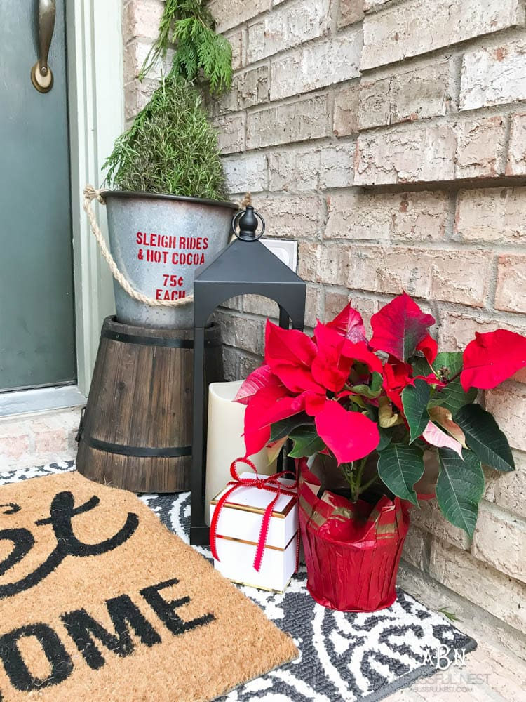 A classic christmas porch and beautiful neutral Christmas dining room idea. See more on https://ablissfulnest.com/ #christmasdecor #christmasideas #christmasfront porch #christmasdecoratingideas