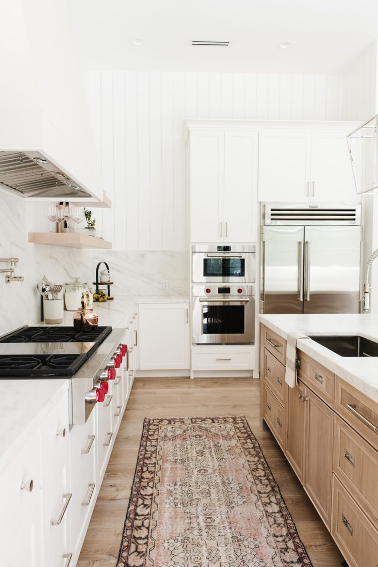 A beautiful two toned kitchen with lots of modern details.