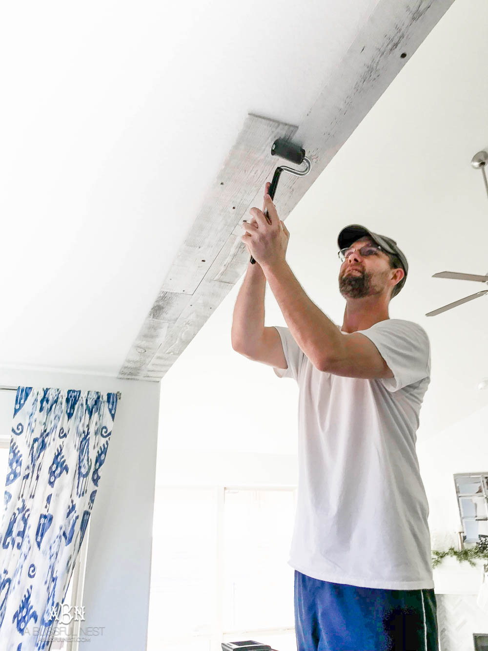 This is the simplest and easy way to install farmhouse barnwood on a ceiling! Just peel and stick these boards from Stikwood for a dramatic makeover to your plain ceiling or wall. More details on https://ablissfulnest.com #farmhousedecor #farmhouseproject #farmhousestyle #ad #stikwood