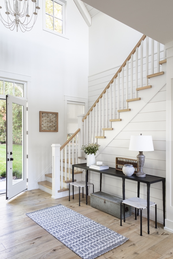 Such a gorgeous coastal entryway featuring shiplap walls, natural wood tones and minimal decor.