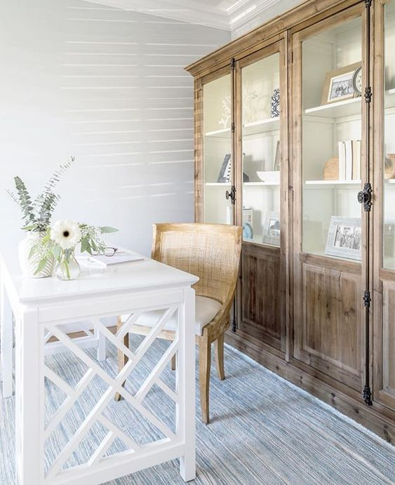 This small office has BIG style with it's beautiful coastal colors and furniture. #smalloffice #officeideas