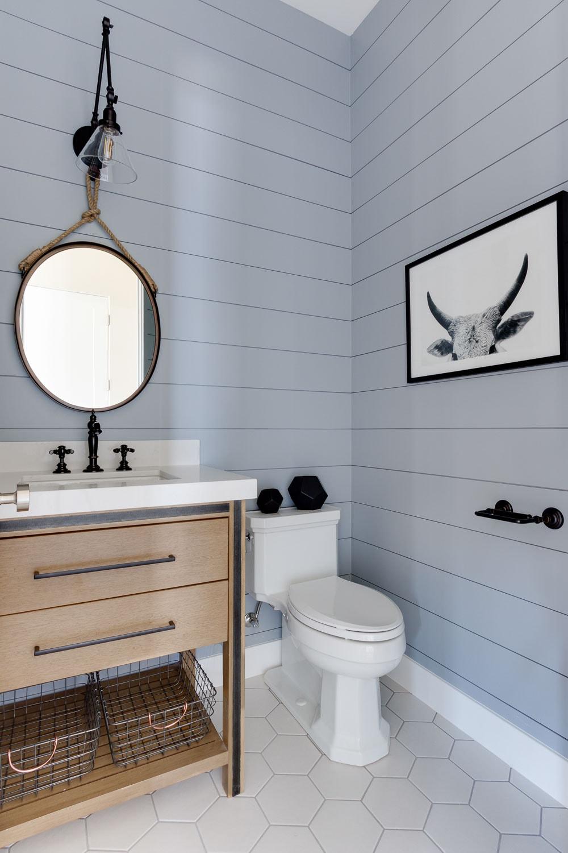 Gorgeous painted blue shiplap in this beautiful modern farmhouse bathroom.