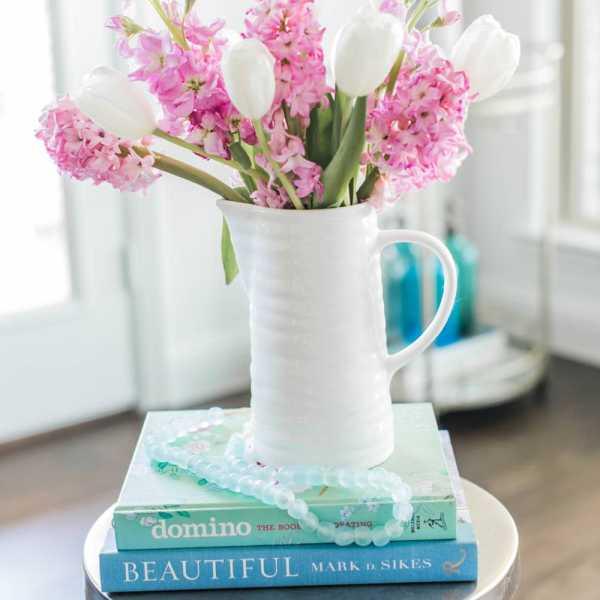 Add colorful books to your spring decor. #ABlissfulNest #springideas #springdecor