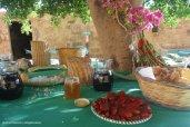 Dinner in progress in the shade of carob tree - Mangiapane Cave, Custonaci