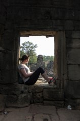 Looking out from one of the side buildings of Bayon, probably getting stares back from the ninety-odd faces in the temple.