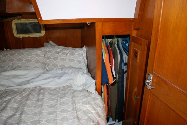 Immediately to starboard is the master cabin with two hanging lockers and drawers