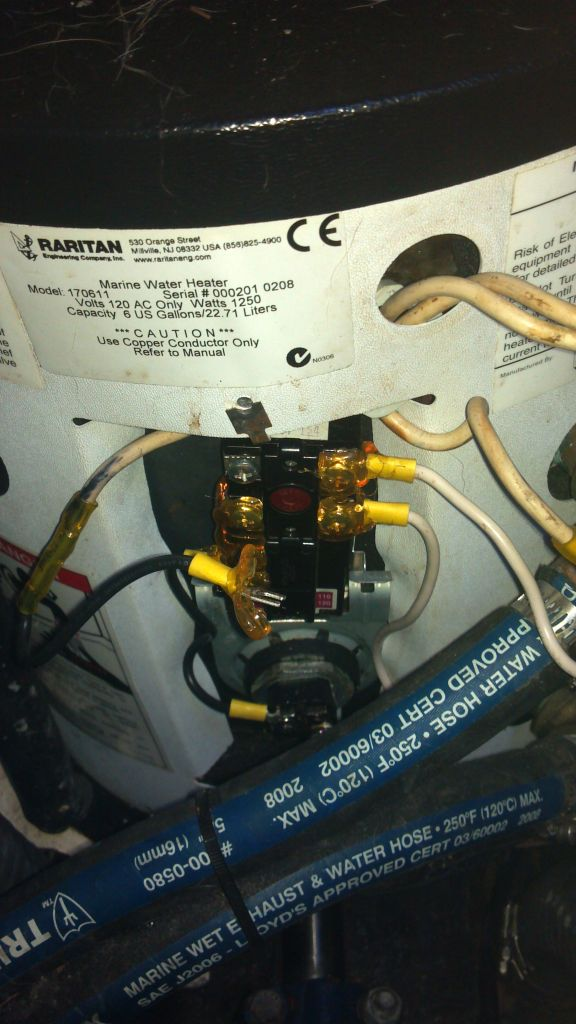 Removing the electrical connections from the water heater. They had waterproof sealant applied over the terminals to prevent shorting if the bilge floods.