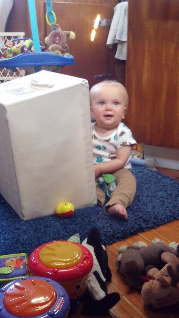 Sullivan playing with his empty toy box