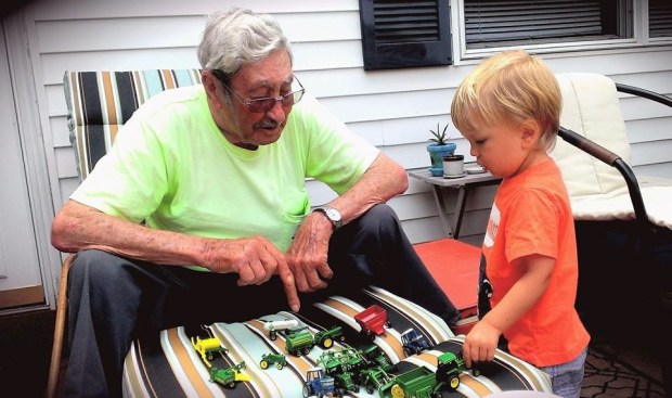 Playing tractors with Sully's Great Grandpa
