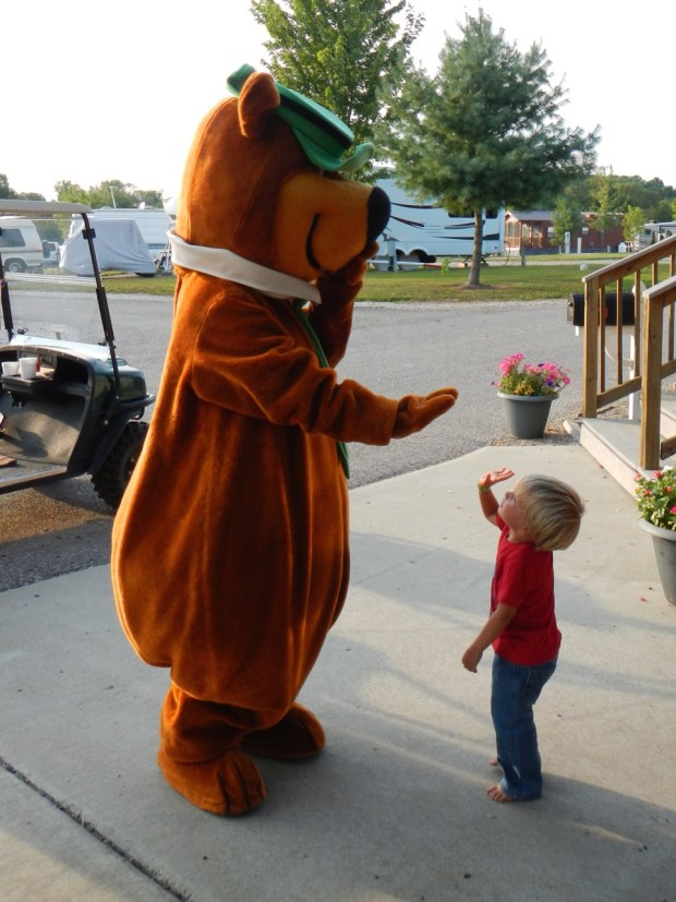 Sully high fived Yogi Bear