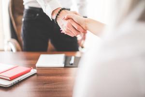 business-man-and-woman-handshake-in-work-office-picjumbo-com