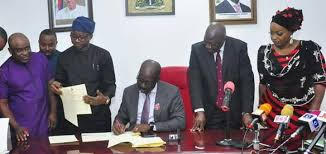 governor of a state signing a bill into law