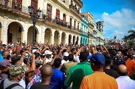 angry mob demonstrating against the government in Cuba