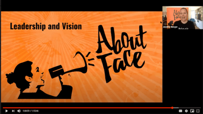 """Screenshot of a video presentation. About-Face's logo and the title """"Leadership and Vision"""" are in the foreground. A screen of Executive Director Jennifer Berger is in the background."""