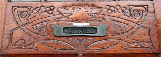 Carved wood mail box Detail of Centraal Apotheek Leeuwarden