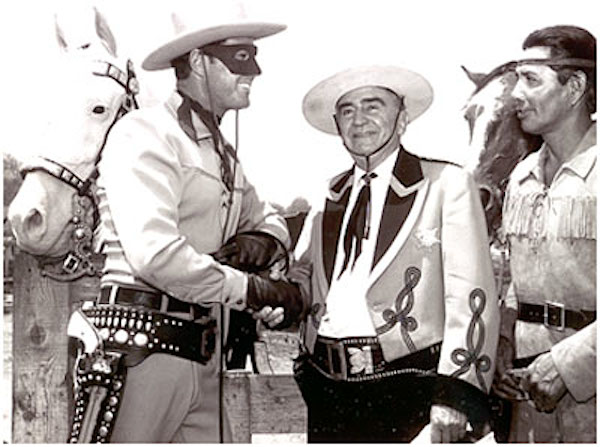 Clayton Moore, Sheriff Eugene Biscailuz, Jay Silverheels at an annual L.A. Sheriff's Rodeo. Note Clayton is wearing the large mask and dark trousers. Silver has no spot in his ear indicating it is the original horse. Also note Clayton's open holster...previously worn by Brace Beemer. (Thanx to Carmen Sacchetti.) www.westernclippings.com