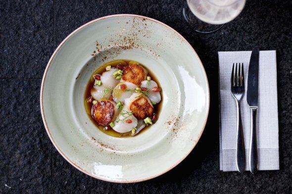 A scallop dish at La Madame, where the cooking nods toward America. Marti Kilpatrick