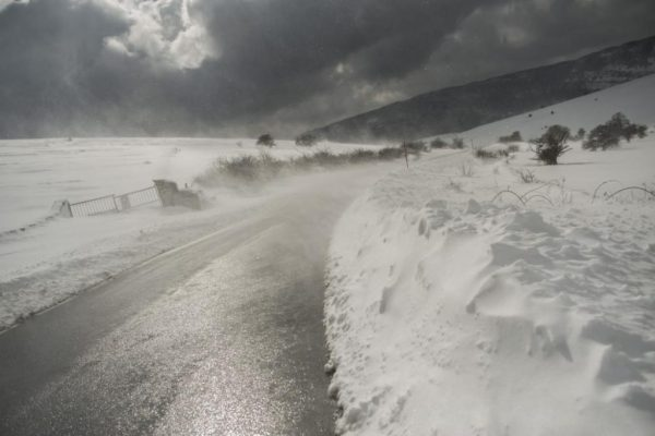The wind blows snow on a road, in Lizarraga northern Spain, Wednesday, Feb. 4, 2015. A cold spell has reached northern Spain with temperatures plummeting far below zero. (AP Photo/Alvaro Barrientos)