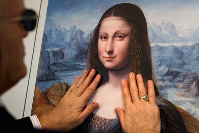 "A visitor at Madrid's Museo del Prado examines a three-dimensional version of a painting in the museum's collection. The painting is a copy of the ""Mona Lisa"" made by a pupil of Leonardo da Vinci. Credit Pablo Blazquez Dominguez/Getty Images"