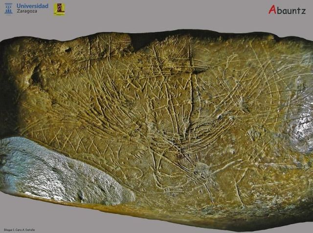 Image of the rock found in Abauntz cave with a map etched on it