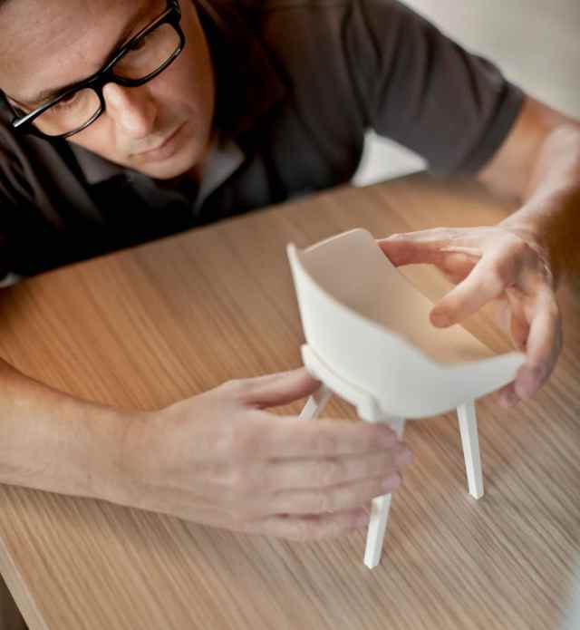 Jean Louis Iratzoki checking the 3D scale model of a chair for Alki. Credit Mito